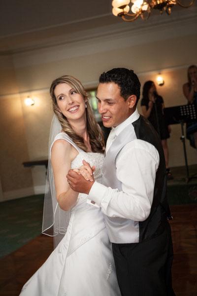 bride and groom waltzing.