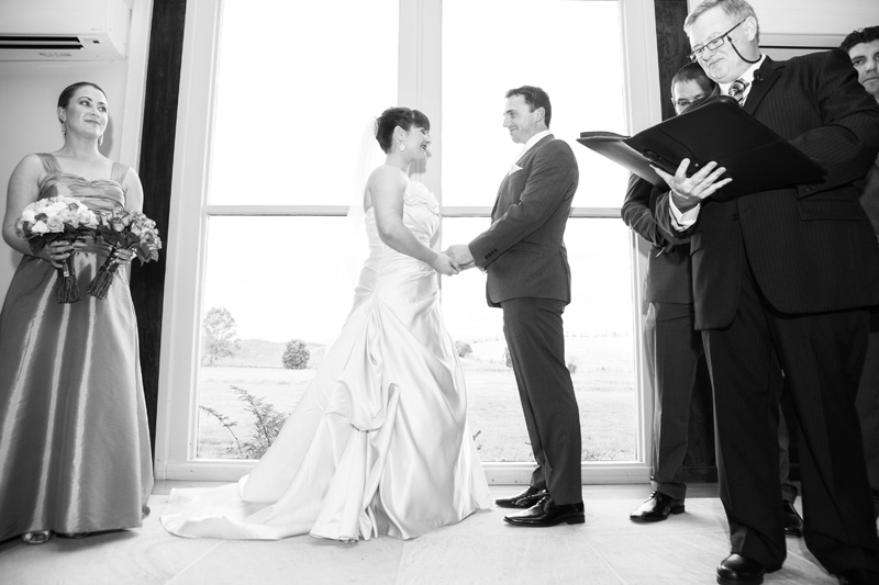 Bride and groom are seen smiling at each other.