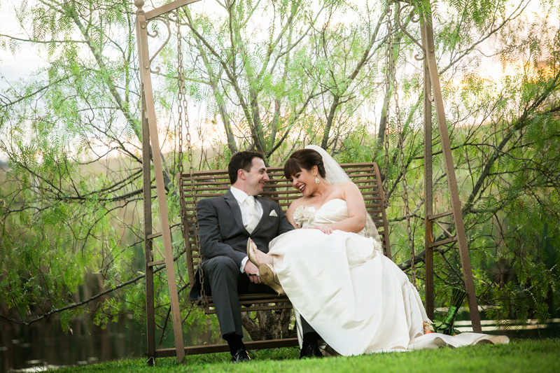 Bride and groom in the garden swing seat.