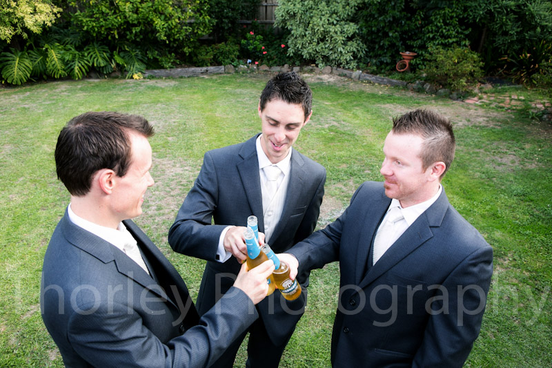 Groomsmen cheers with three drinks before the wedding.