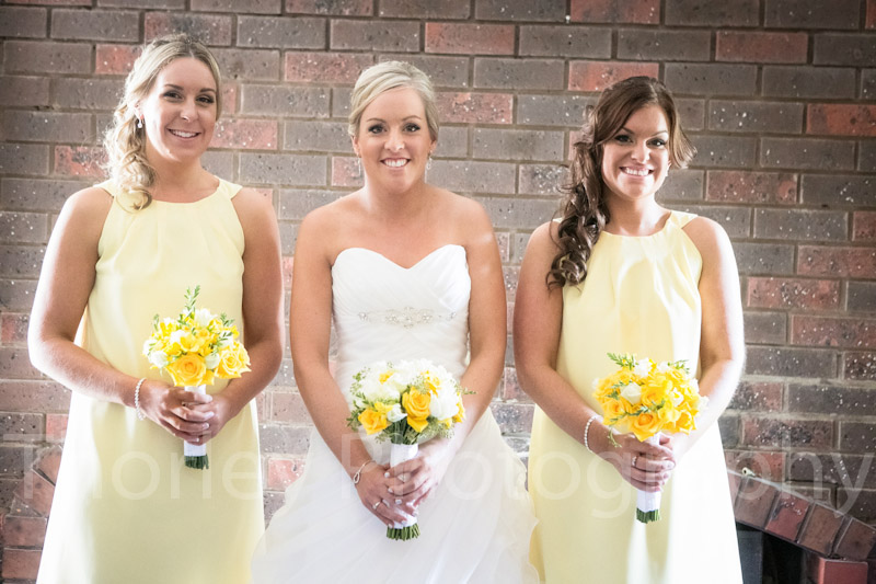 Bride with her two brides holding bouquet's.