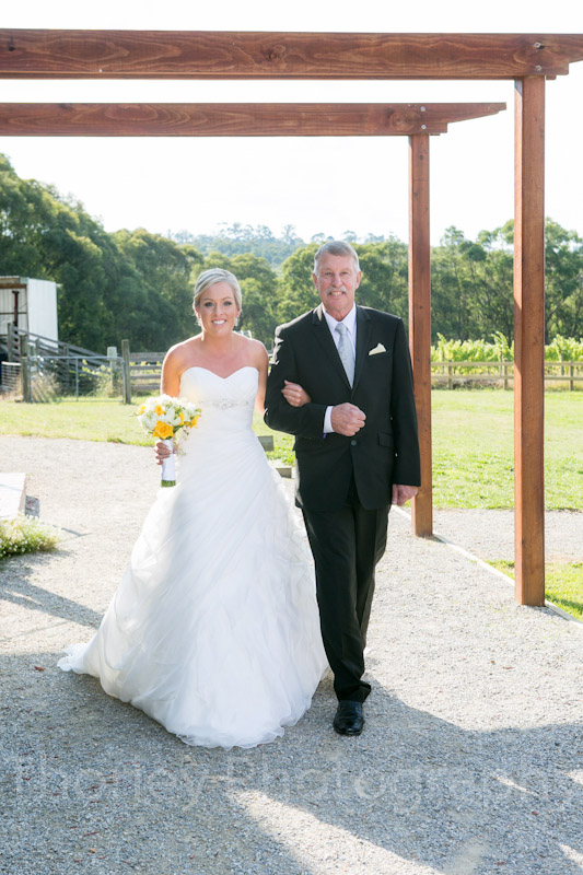 Photo of the bride walking down the aisle with her father at Yarra Ranges Estate.