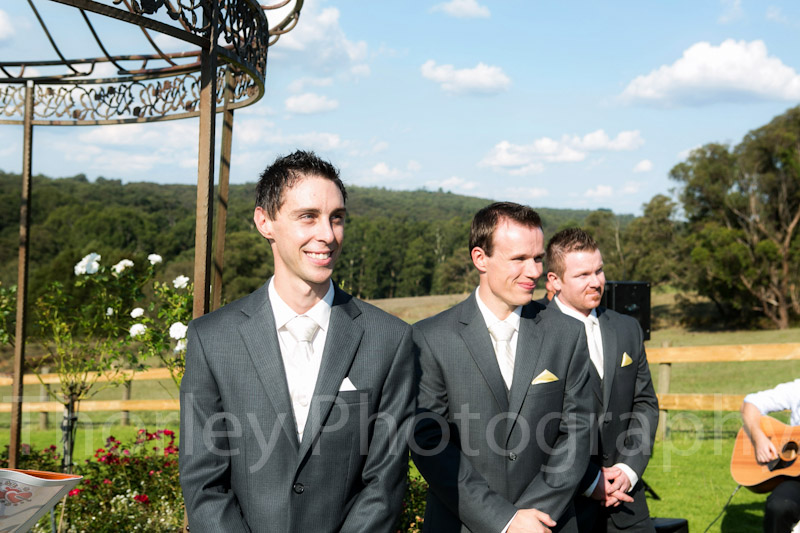 The groom's face as he first see's his bride comming down the aisle.