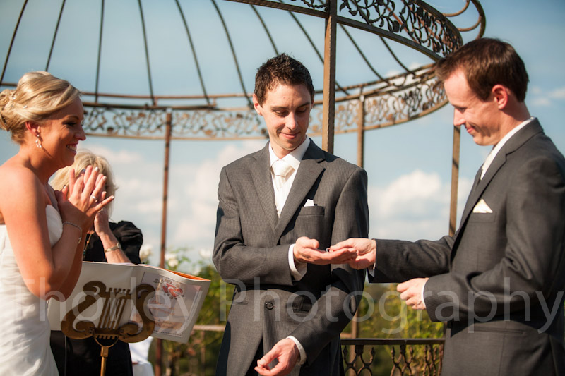 Best man hands over the ring.
