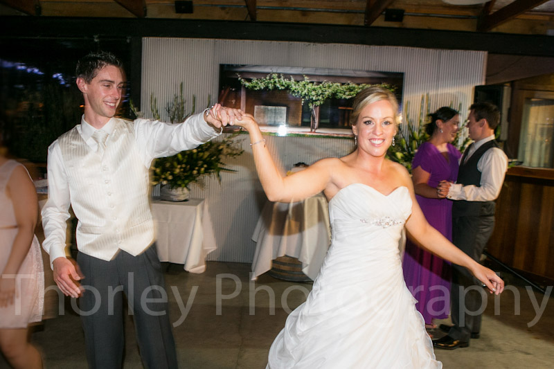 Hands held and smiles in photo of the bridal dance.