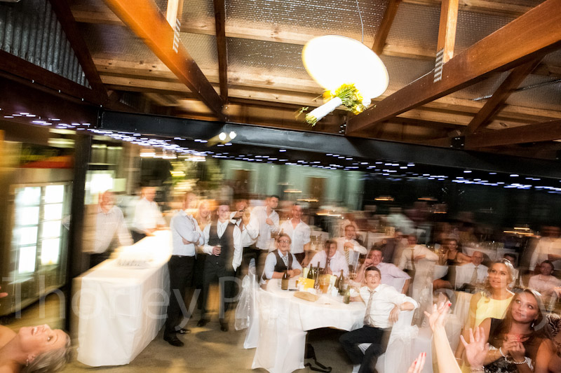 The thrown bouquet hits the ceiling light.