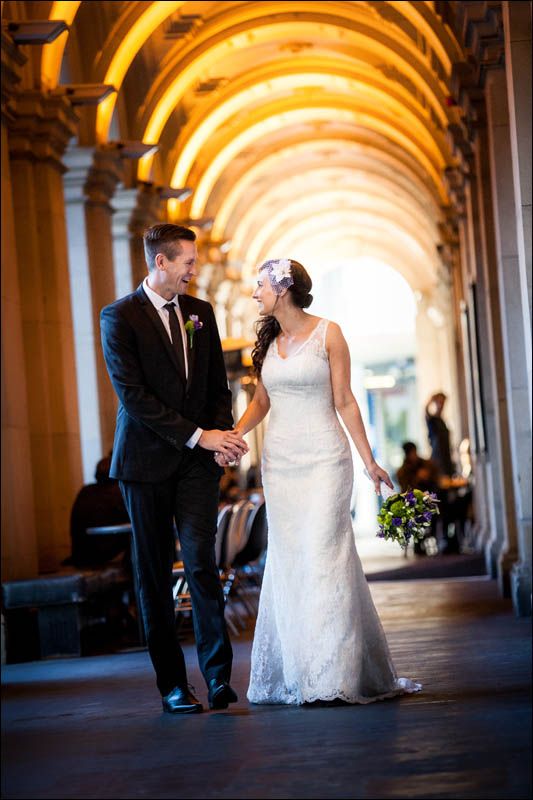 Bride and groom walking through Melbourne GPO
