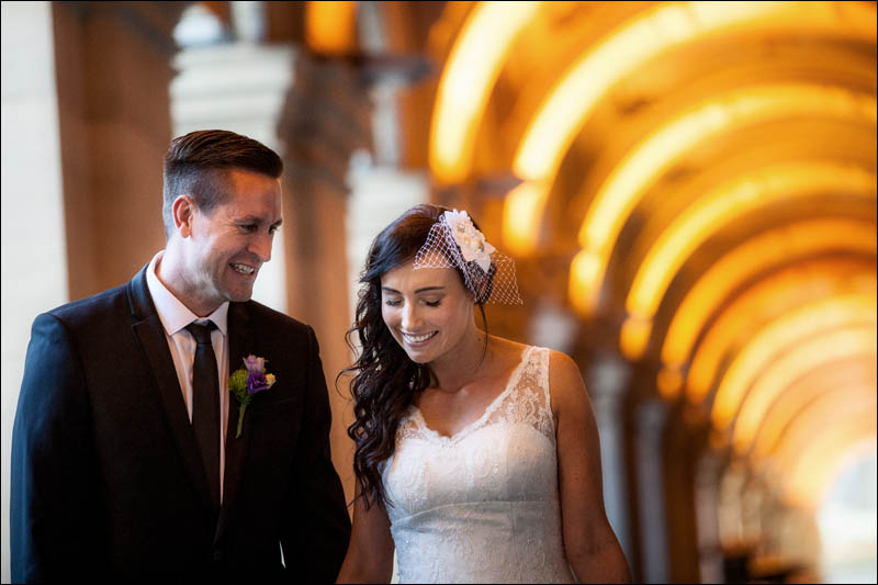 Bride and groom holding hands in Melbourne GPO