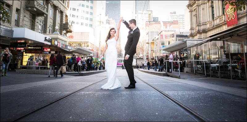 Bride and groom on Swanston street tram tracks